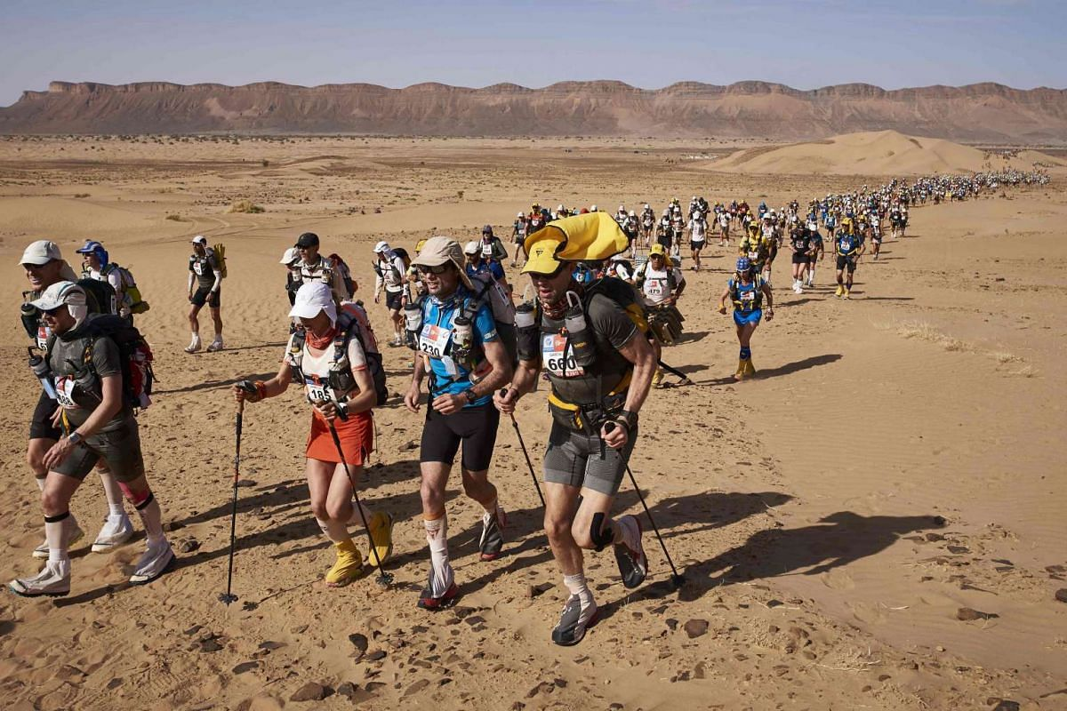 A competitor takes part in Stage 3 of the 32nd edition of the Marathon des Sables between Rich Mbirika and Nord El Maharch in the southern Moroccan Sahara desert on April 11, 2017.
