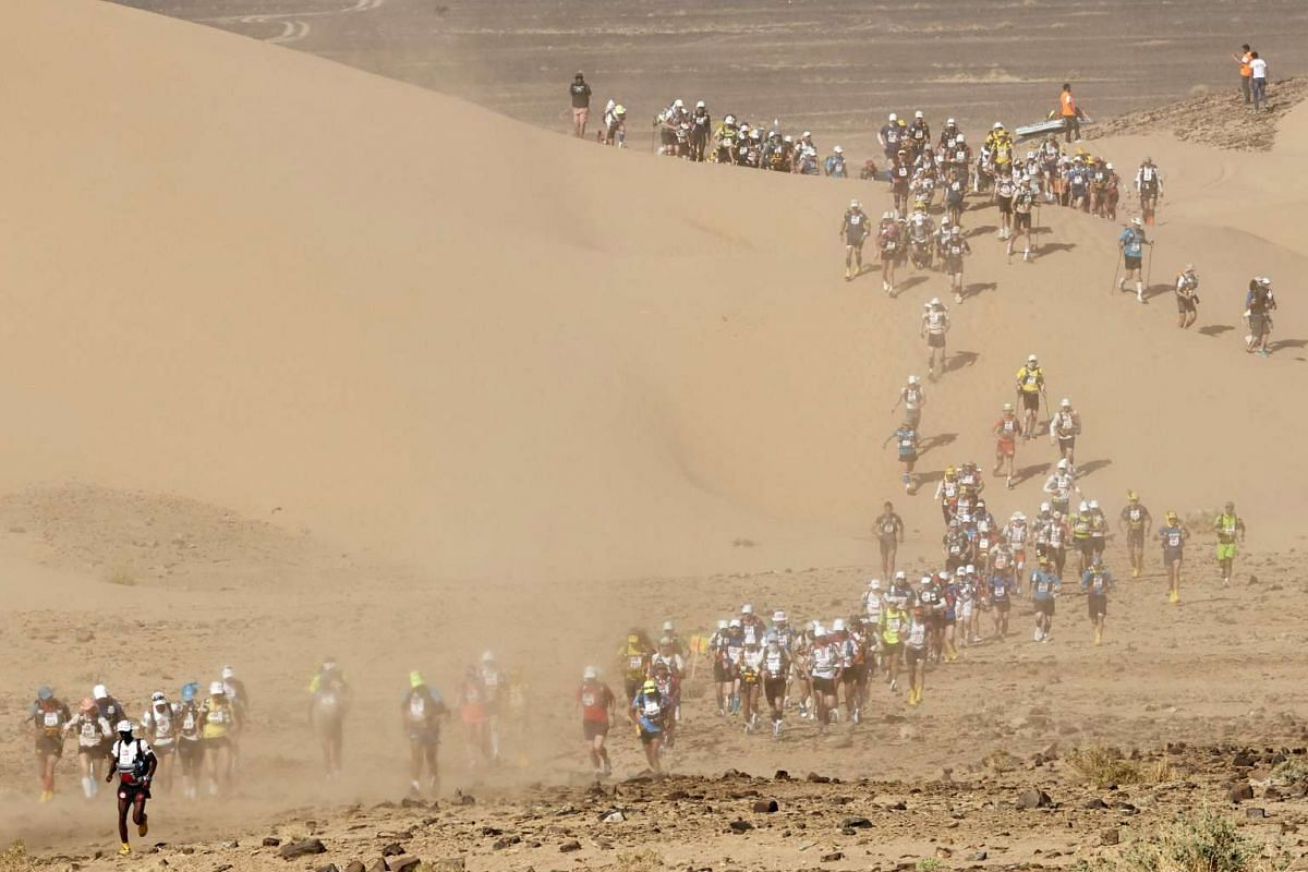 Competitors take part in Stage 3 of the 32nd edition of the Marathon des Sables between Rich Mbirika and Nord El Maharch in the southern Moroccan Sahara desert on April 11, 2017.