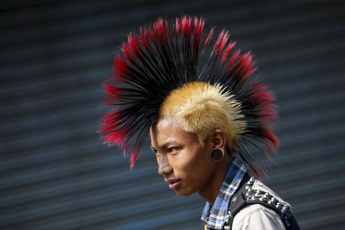 A punk with a mohawk hairstyle at the gathering.