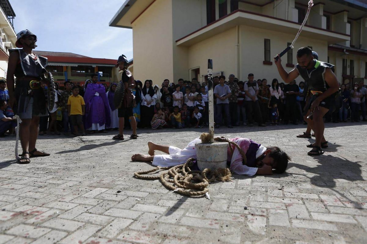 People re-enact the crucifixion of Jesus in Banda Aceh, Indonesia.