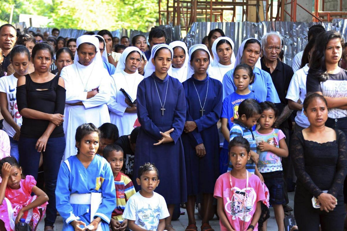 Worshippers gather at a re-enactment of the crucifixion of Jesus Christ in Dili, Timor Leste.