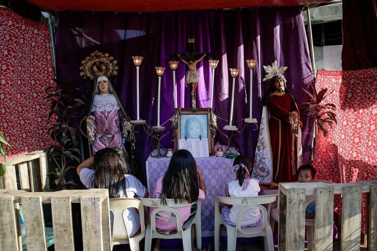 Filipino children at prayer ahead of Good Friday celebrations in San Fernando in the Philippines.