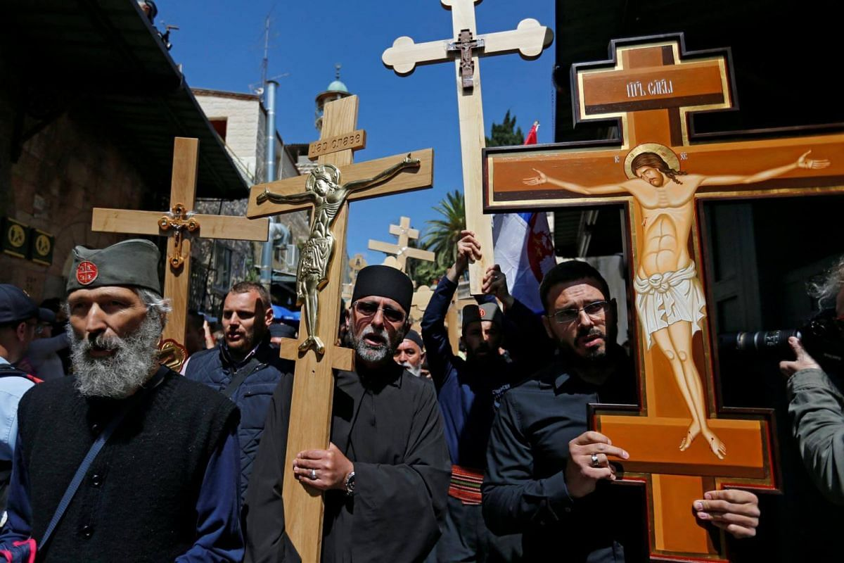 Worshippers carry crosses during a Good Friday procession along Via Dolorosa in Jerusalem's Old City.