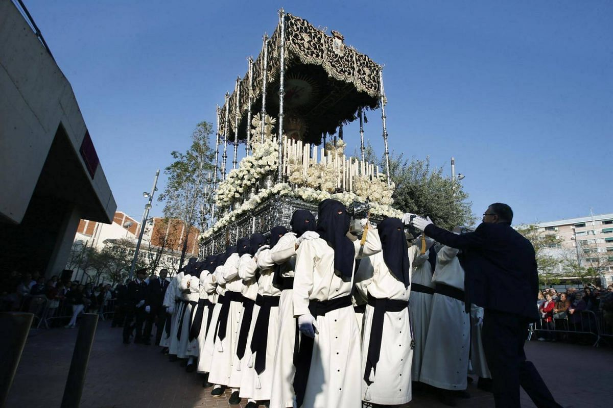 Devotees carry a statue of Our Lady of Pain during a secular procession of the Nazarenes brotherhood in L'Hospitalet de Llobregat, Catalonia in north-eastern Spain.
