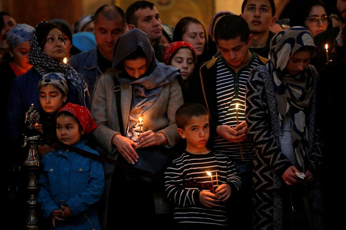 Devotees attend a Good Friday service at Holy Trinity cathedral in Tbilisi, Georgia.