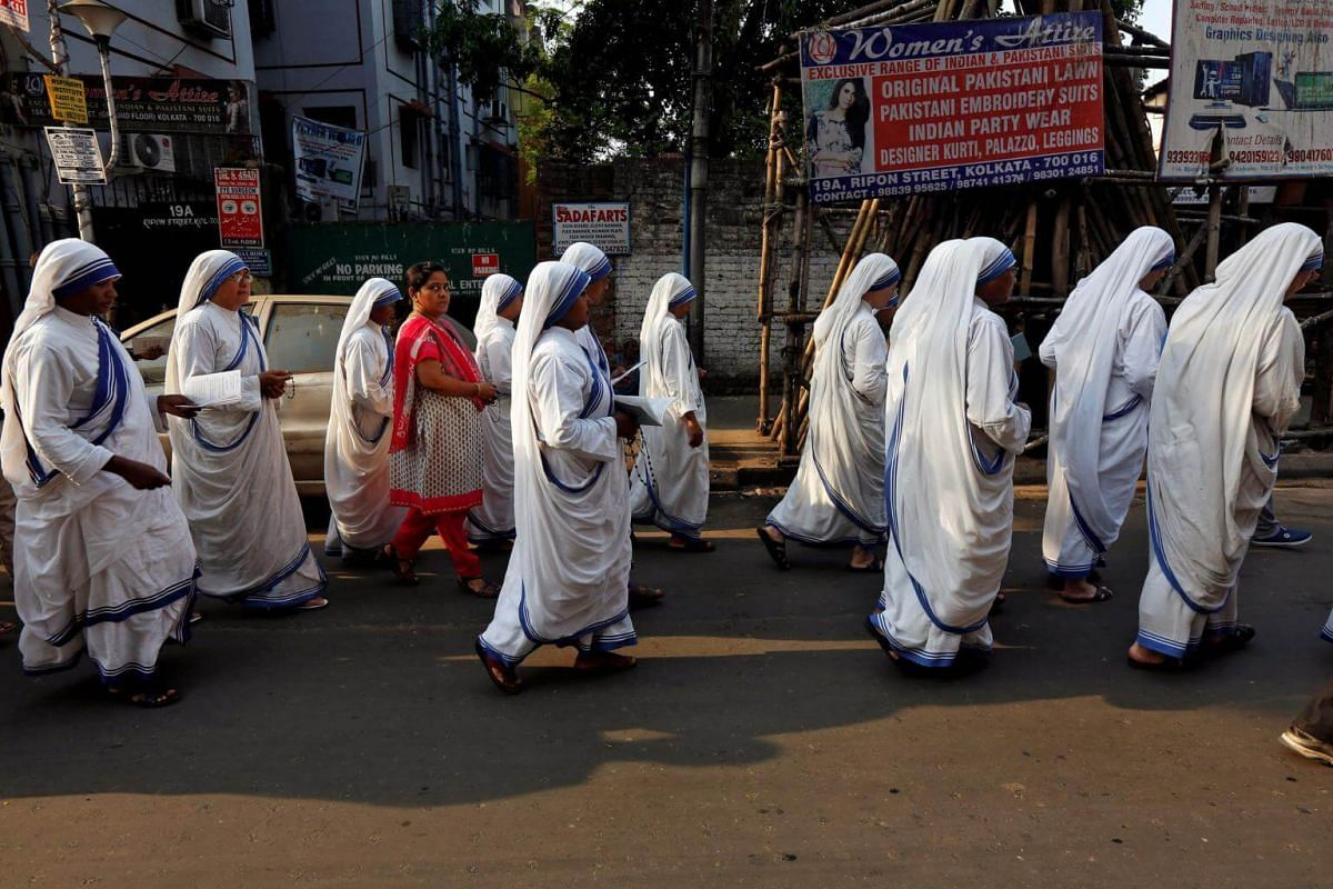 Catholic nuns from the Missionaries of Charity attend a Good Friday procession in Kolkata, India.