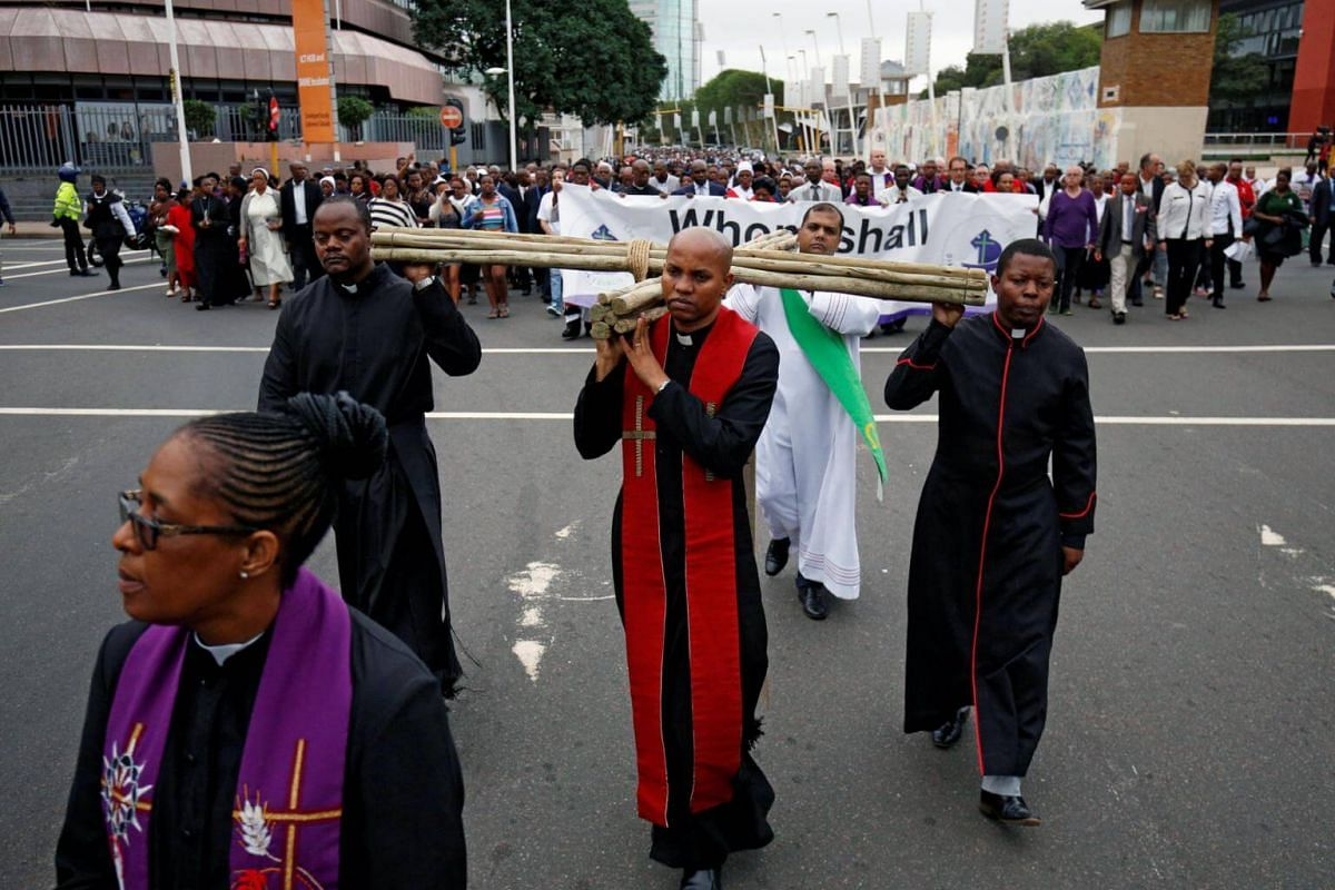 Religious leaders carry a cross during a silent Good Friday march in Durban, South Africa.