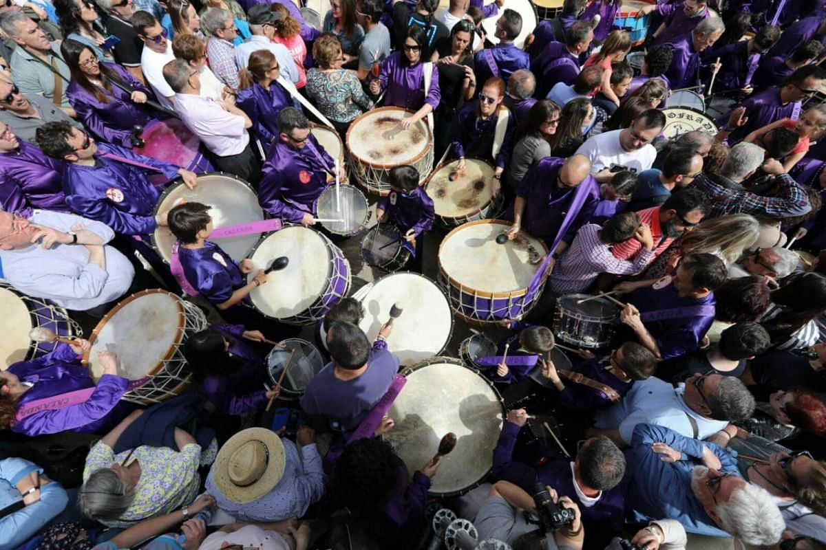 Revellers take part in the 'rompida de la hora', a 24-hour drumming session that starts at noon on Good Friday and ends at the same time the following day on Easter Saturday, in Calanda, Aragon in Spain.