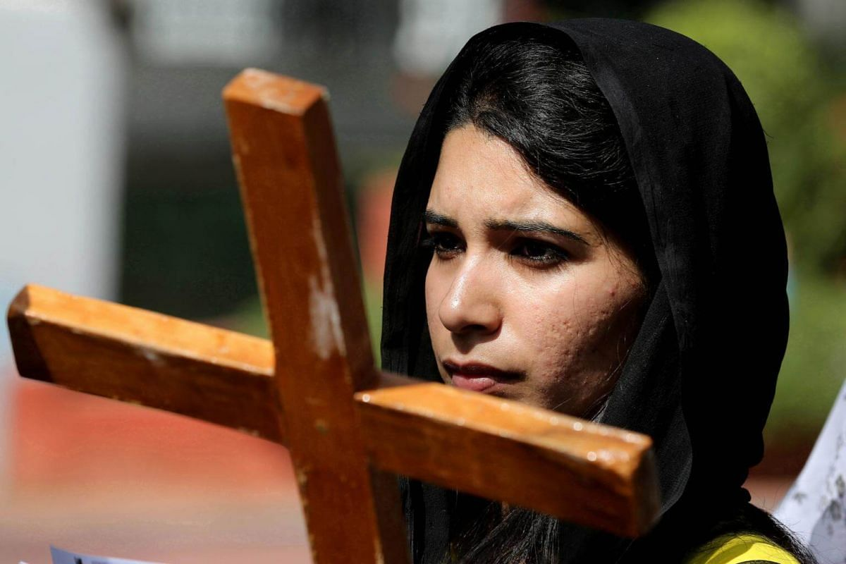 A Christian devotee carries a wooden cross during a procession on the occasion of Good Friday in Bhopal, India.