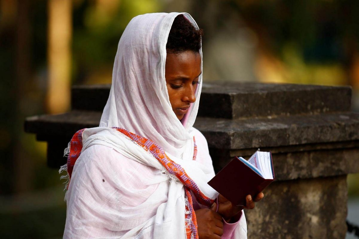 A woman attends a prayer session outside the Holy Trinity Cathedral in Addis Ababa, Ethiopia.