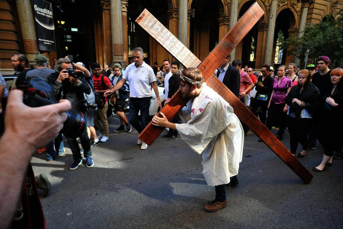 Performer Brendan Paul plays the part of Jesus Christ during a 'Journey to the Cross' procession in Sydney, Australia.