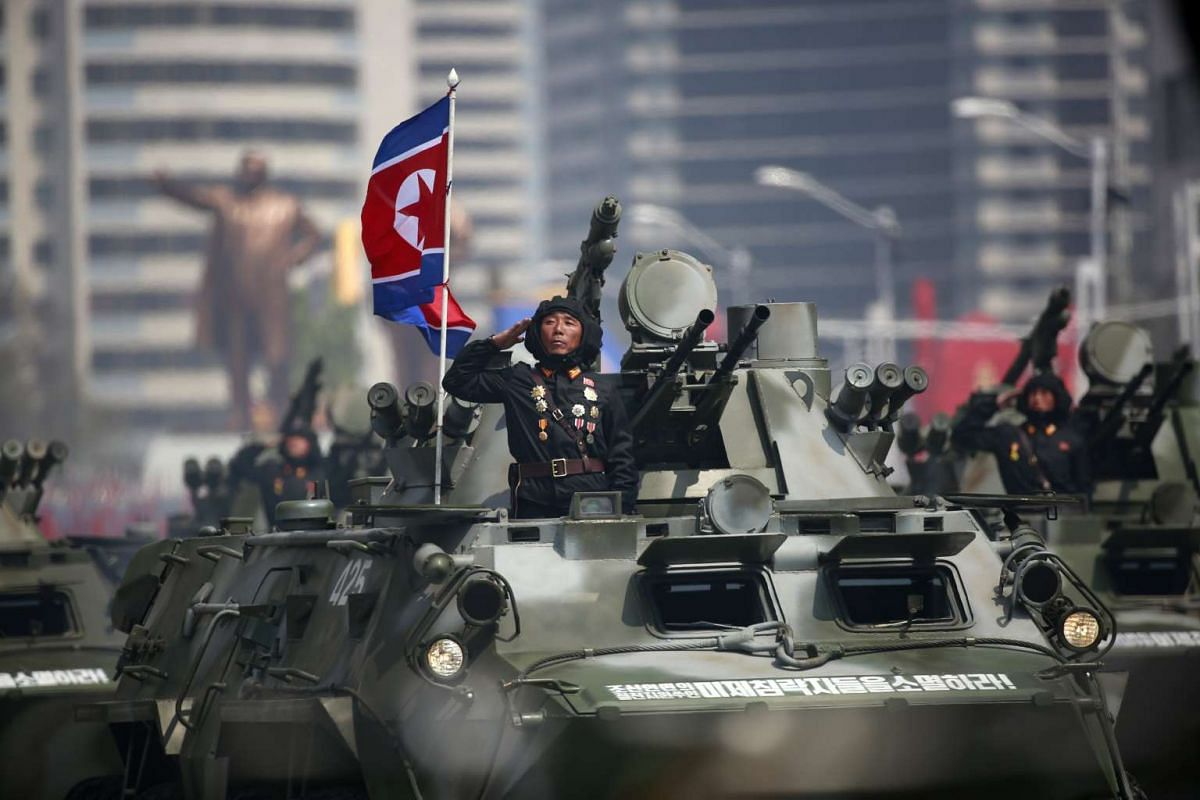North Korean soldiers on military armoured vehicles drive past during a parade for the 'Day of the Sun' festival on Kim Il Sung Square in Pyongyang, North Korea, April 15 2017.