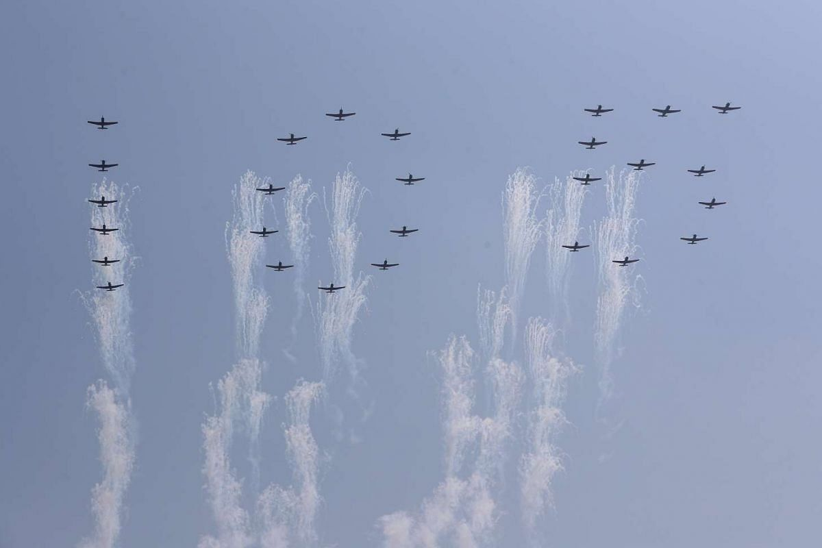 North Korean planes forming the numbers 105 fly past during a parade for the 'Day of the Sun' festival on Kim Il Sung Square in Pyongyang, North Korea, April 15 2017.