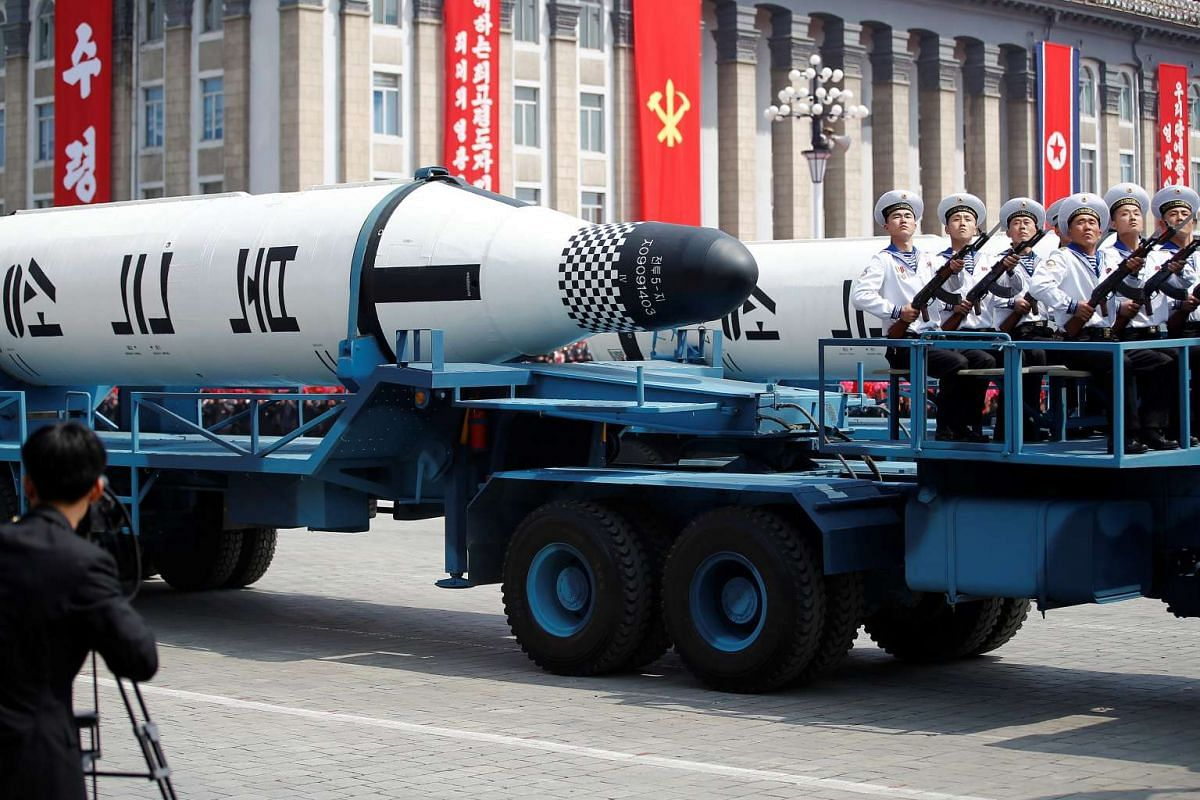 """Military vehicles carry missiles with characters reading """"Pukkuksong"""" during a military parade marking the 105th birth anniversary of country's founding father, Kim Il Sung in Pyongyang, North Korea, on April 15, 2017."""