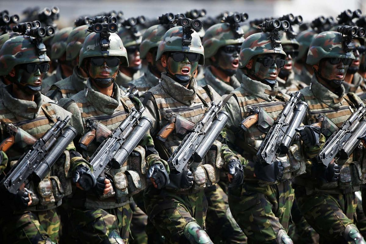 North Korean soldiers march and shout slogans during a military parade marking the 105th birth anniversary of country's founding father, Kim Il Sung in Pyongyang, North Korea on April 15, 2017.