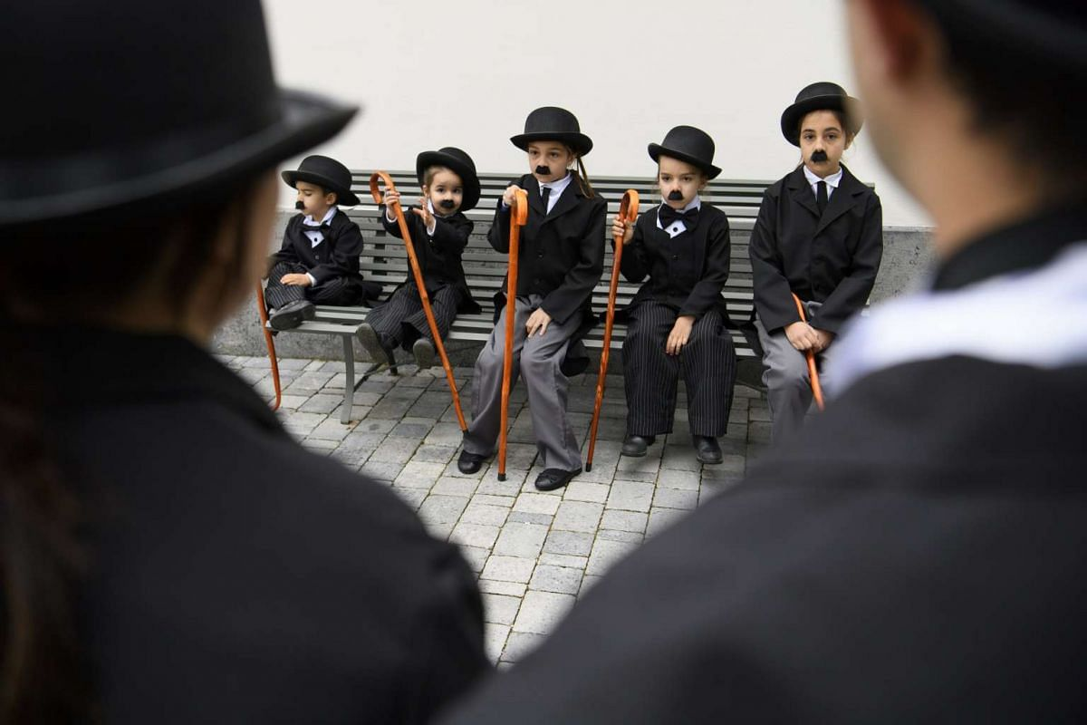 Children dressed as Charlie Chaplin were part of a group of  some 662 people who dressed up as the English comic actor and posed for a group photo in front of the Manoir de Ban in Corsier, above Vevey, Switzerland, April 16, 2017. PHOTO: EPA