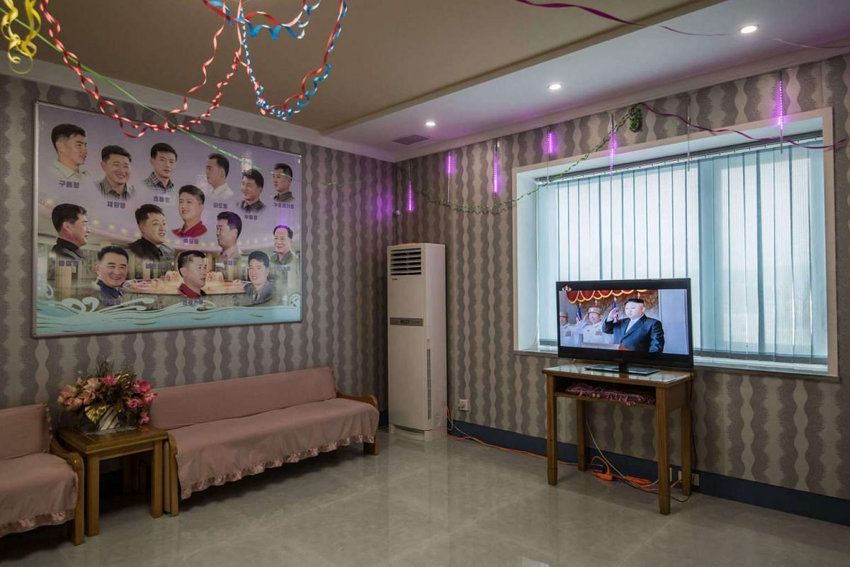 A television shows footage of North Korean leader Kim Jong Un during a military parade at a barber shop inside a leisure centre during an organised tour for visiting foreign journalists, in Pyongyang on April 16, 2017.