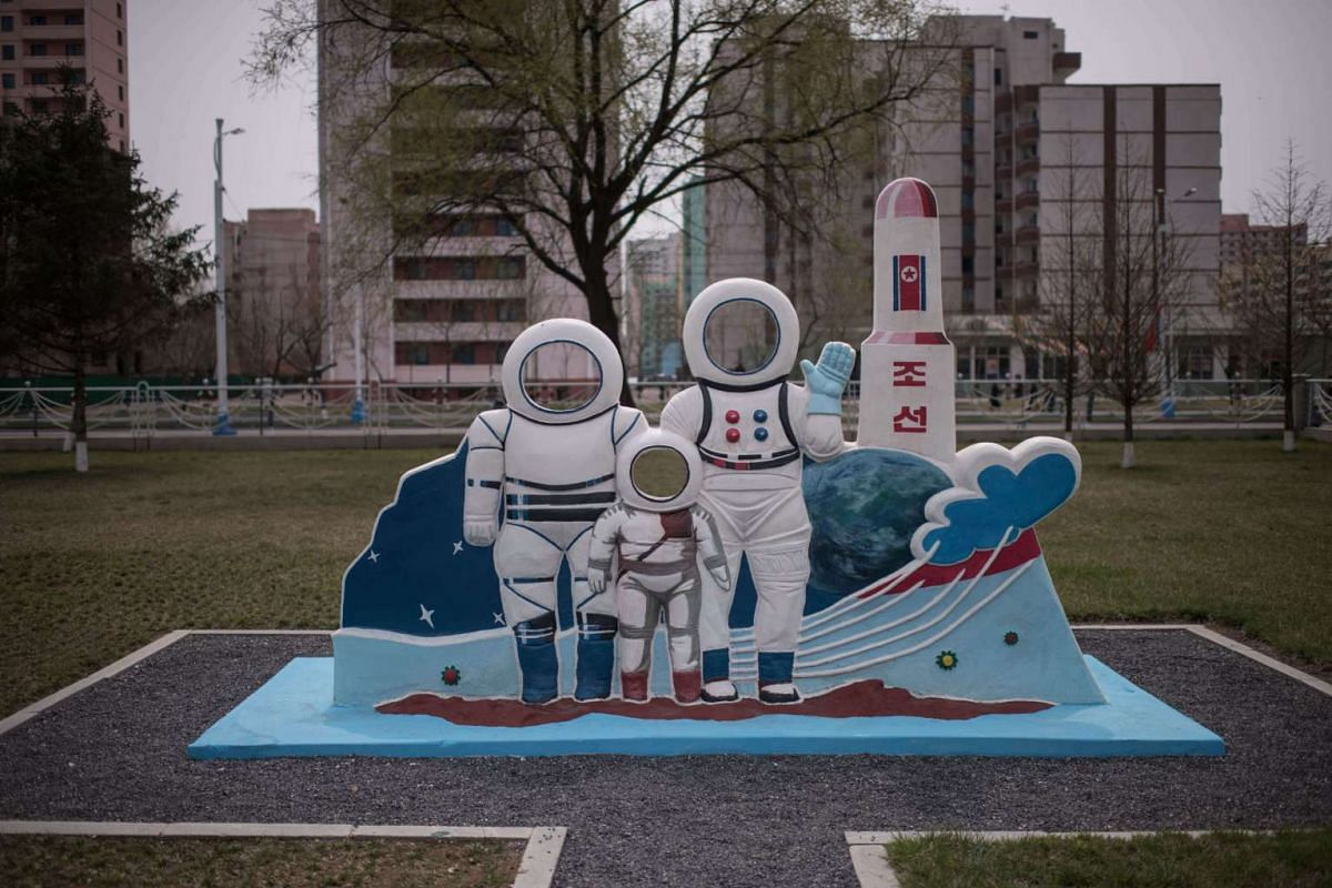 A photo position shows astronauts and a rocket outside a leisure centre during an organised tour for visiting foreign journalists, in Pyongyang on April 16, 2017.