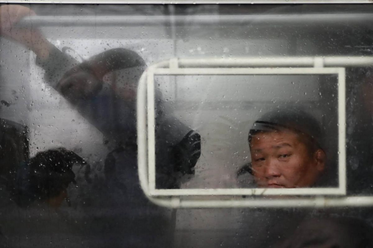 A North Korean commuter is seen through a tram window in Pyongyang, North Korea, on April 14, 2017.