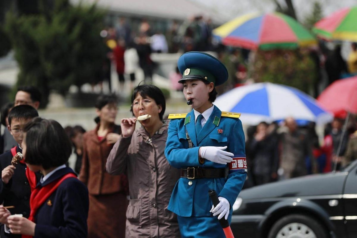 A North Korean traffic police-woman directs traffic in Pyongyang, North Korea, on April 16, 2017.