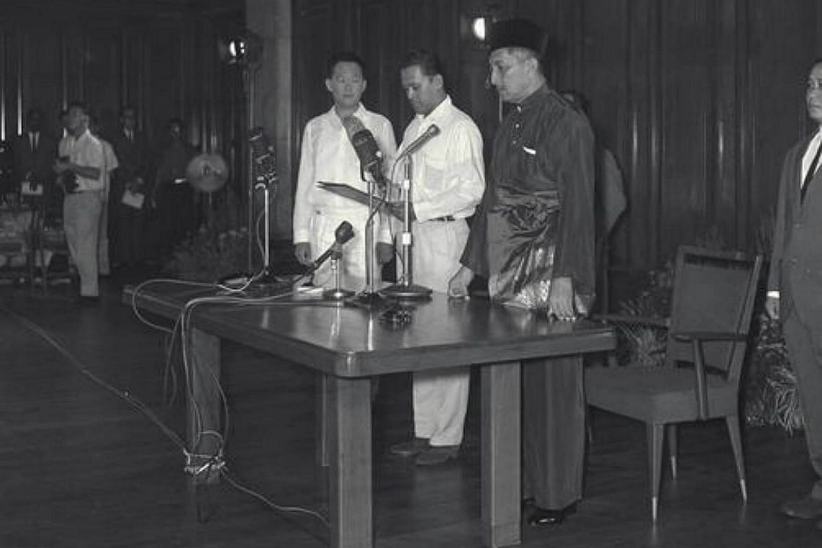 Mr Othman Wok taking his oath at the City Hall in 1963.