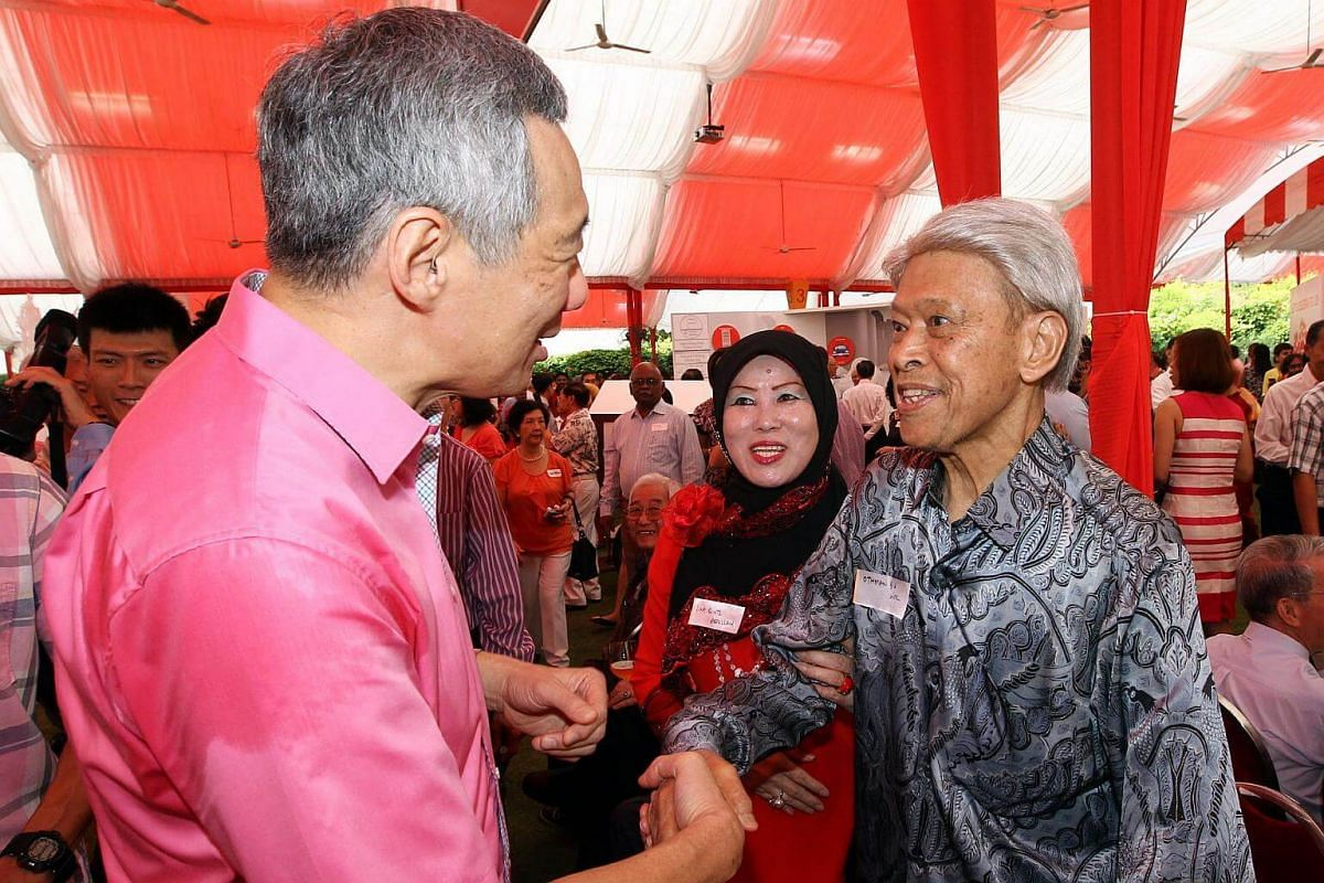 Prime Minister Lee Hsien Loong (left) shaking hands with former minister Othman Wok, accompanied by his wife Madam Lina Abdullah, at the Pioneer Generation Tribute ceremony on Feb 9, 2014.