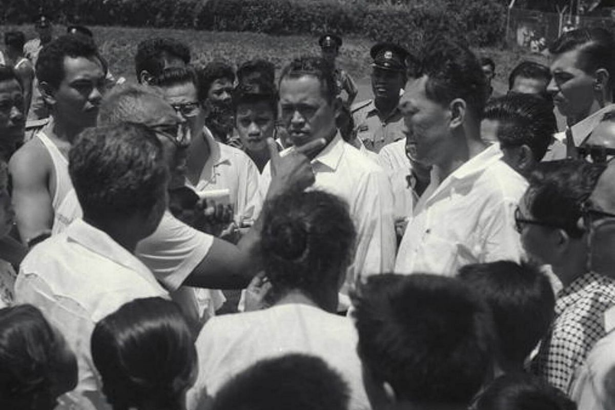 Prime Minister Lee Kuan Yew, accompanied by the Minister for Social Affairs Othman Wok, toured troubled areas to meet goodwill committees and community leaders during the racial riots in 1964.