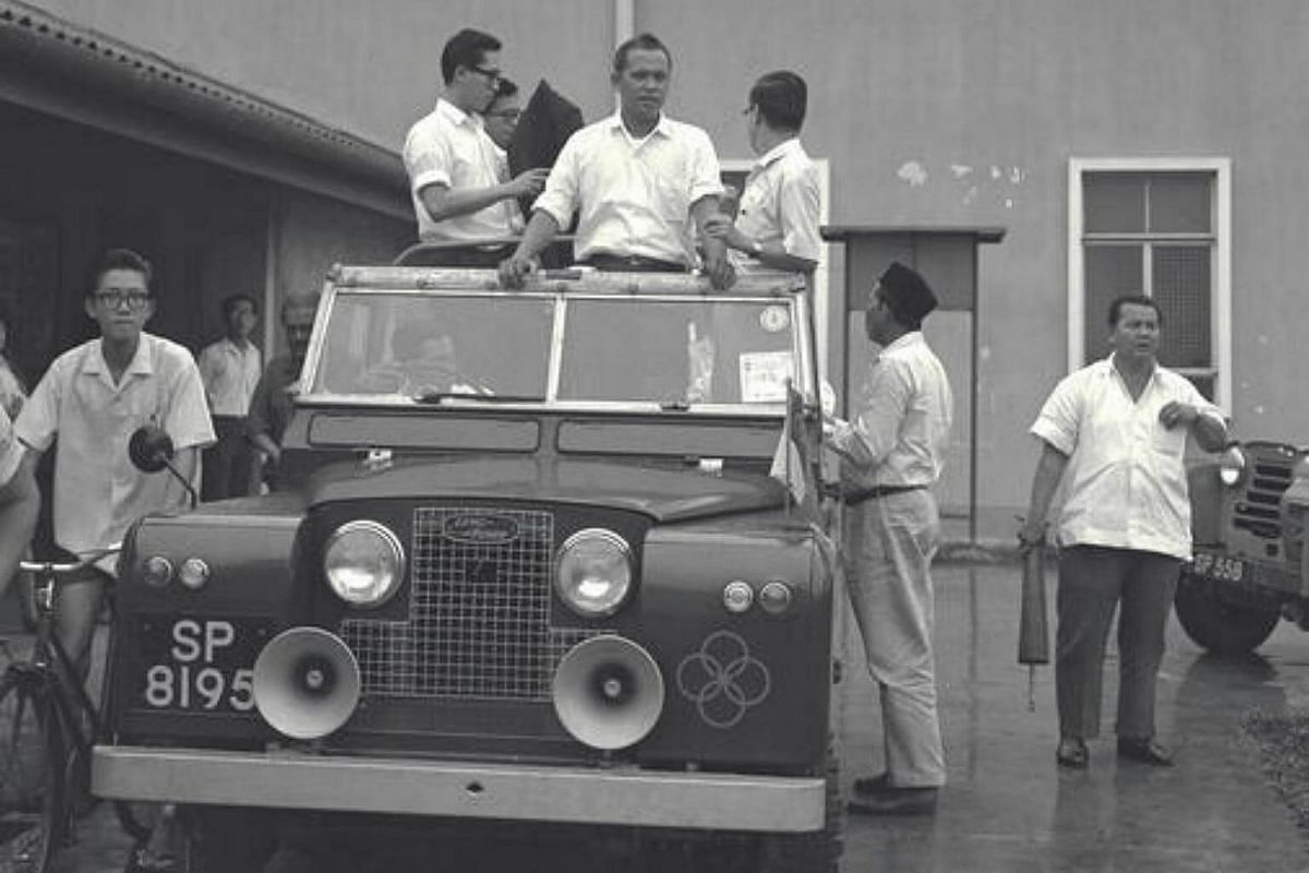 Minister for Social Affairs Othman Wok during a tour of the Mountbatten area where he met goodwill committee leaders during the racial riots in 1964.