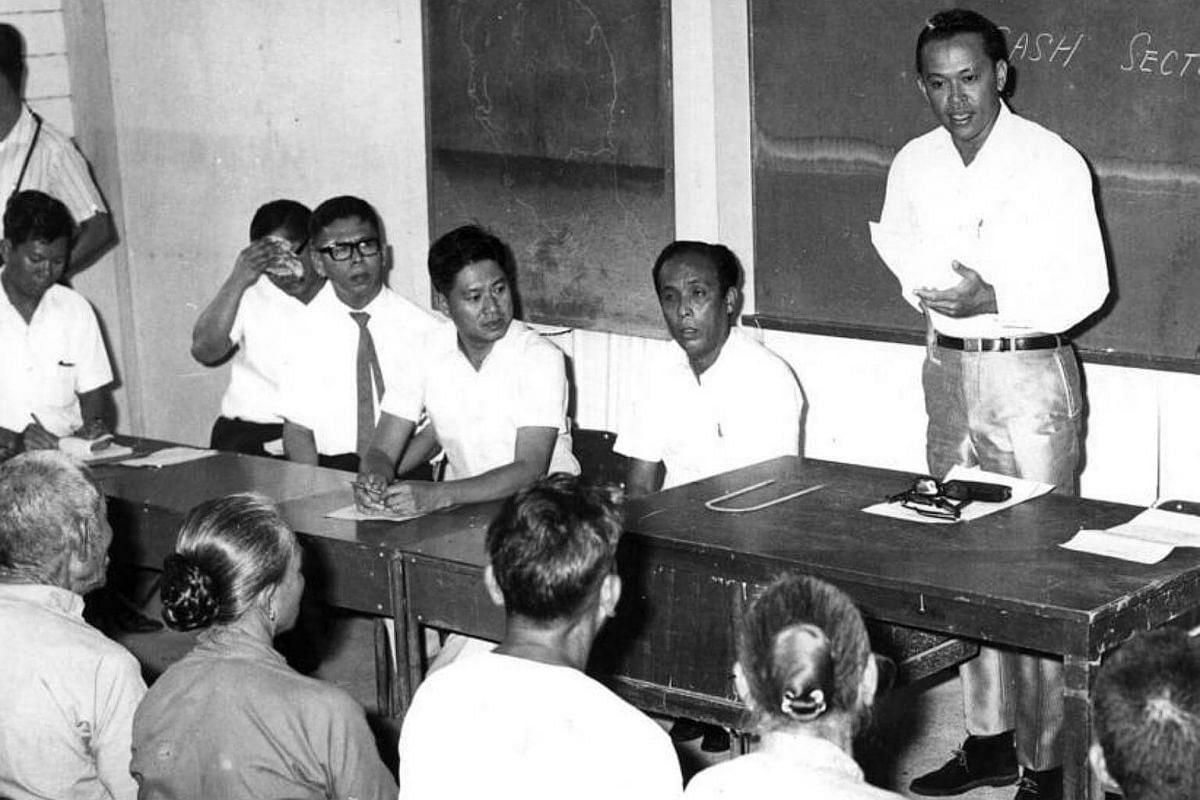 Mr Othman Wok (standing) with former MP for Kallang Haji Buang Omar Junid (second from right) with residents during a meet-the-people session.