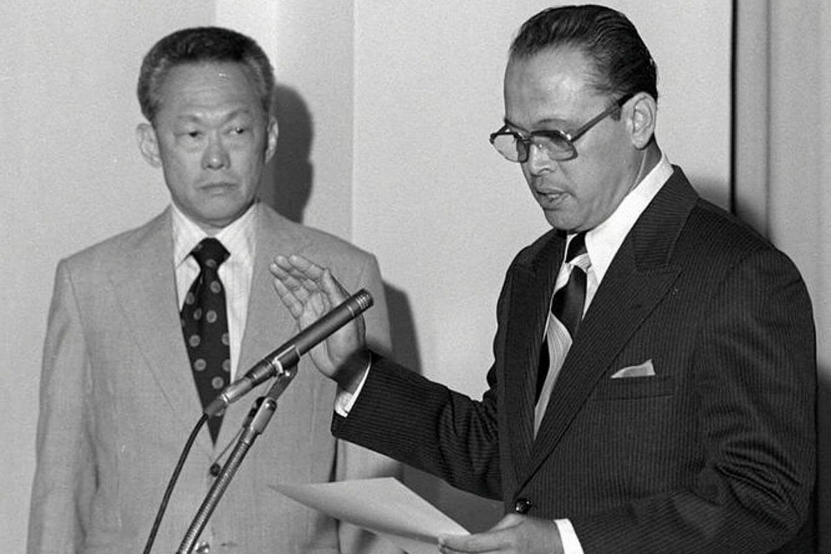 Prime Minister Lee Kuan Yew (left) and Mr Othman Wok, who was Minister of Home Affairs and Social Welfare from 1963 and ambassador to Indonesia from 1977, at the swearing-in ceremony at the Istana, in 1976.