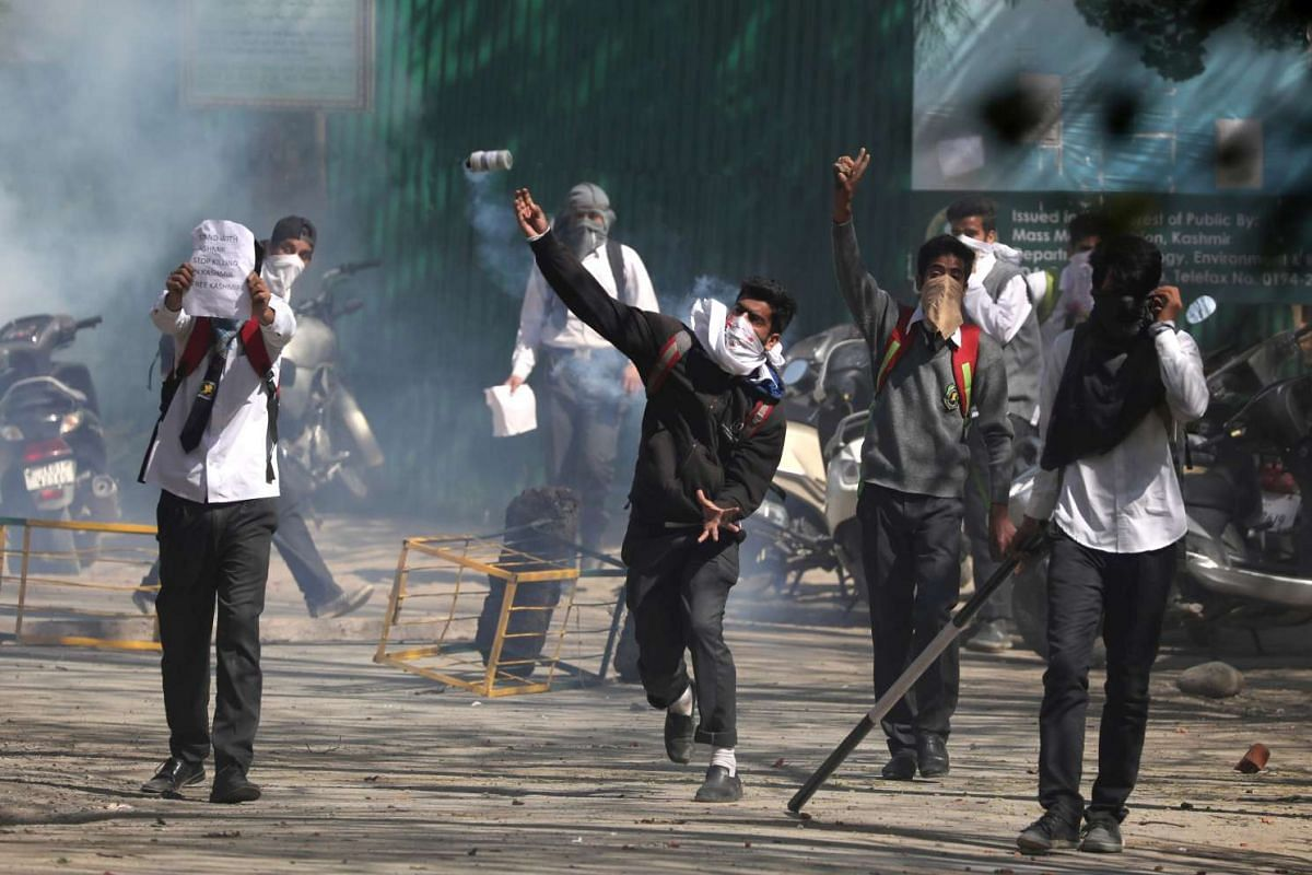 Kashmiri students throw stones at Indian police during clashes at a school in Srinagar, the summer capital of Indian Kashmir, April 17, 2017. PHOTO: EPA