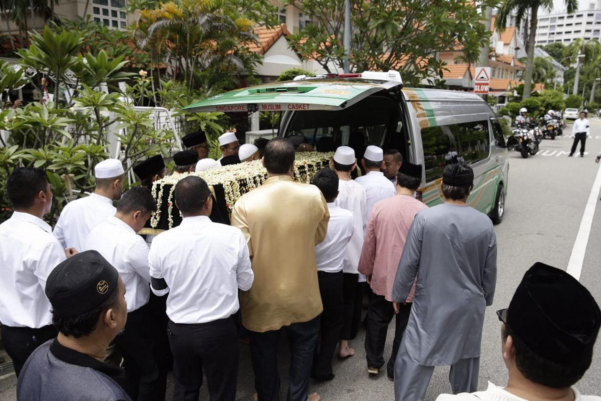 Family members and friends carrying Mr Othman Wok's casket, before the van makes its way to the Sultan Mosque.