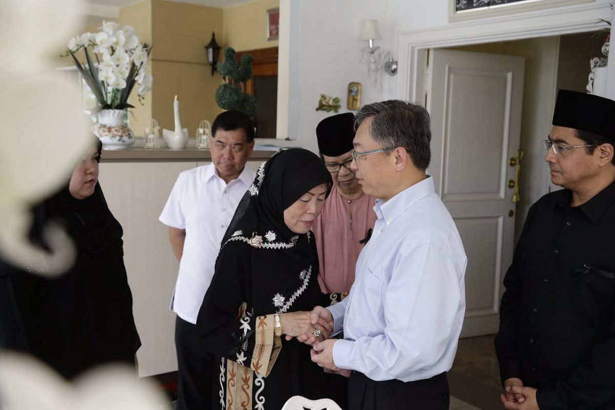 Health Minister Gan Kim Yong offers sympathies to Mr Othman's widow, Lina.