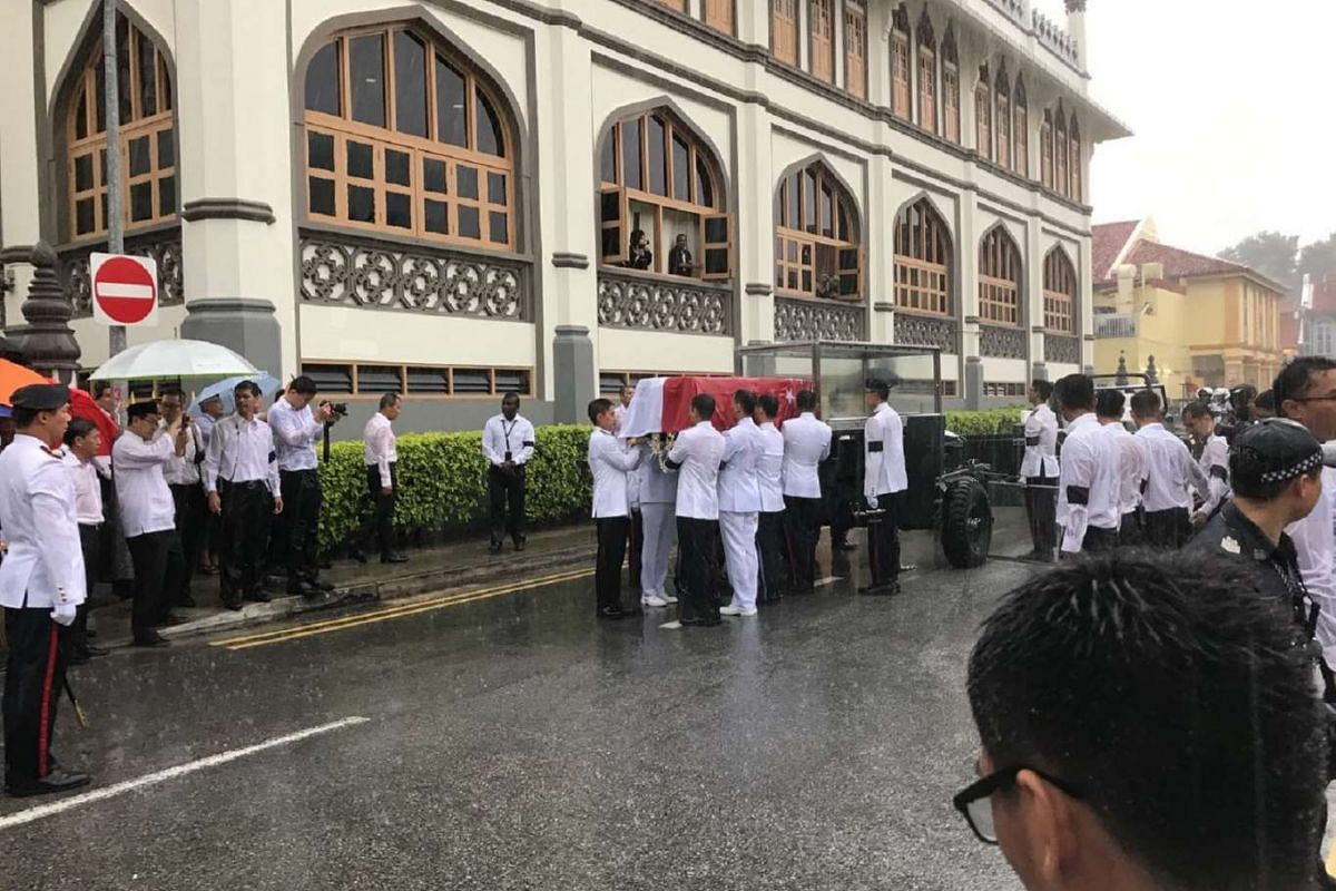 The late Mr Othman Wok's casket being placed on the gun carriage.