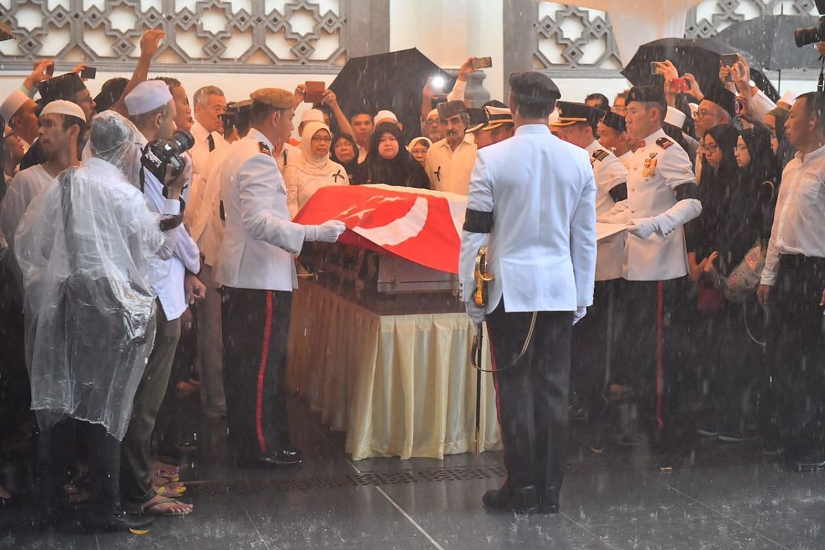A state flag draped over the casket, with the crescent and stars lying over the head and close to the heart of the late Mr Othman Wok.