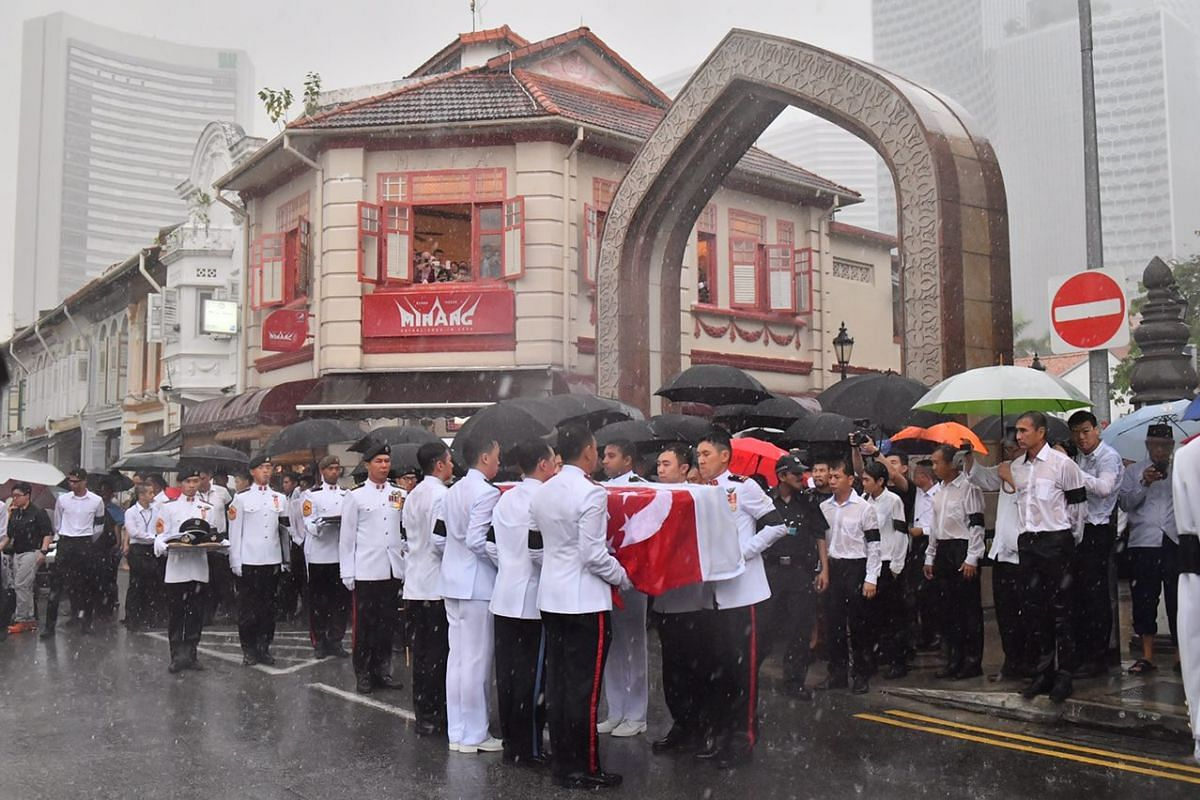 The late Mr Othman Wok's casket being carried out of the mosque.