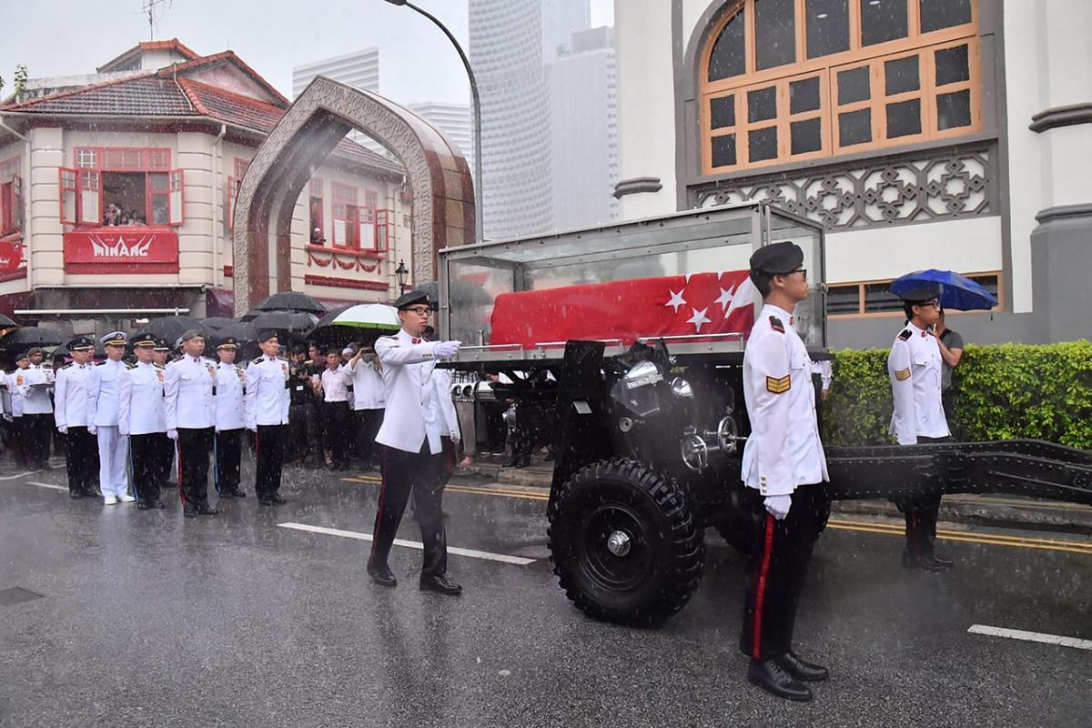 The late Mr Othman Wok's casket in the gun carriage.