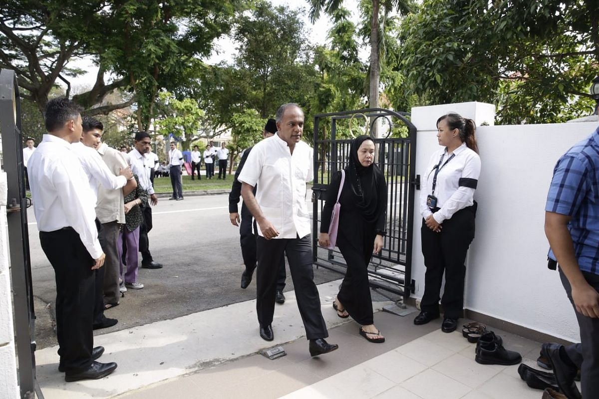 Law Minister K Shanmugam arrives to pay respects to the late Othman Wok.