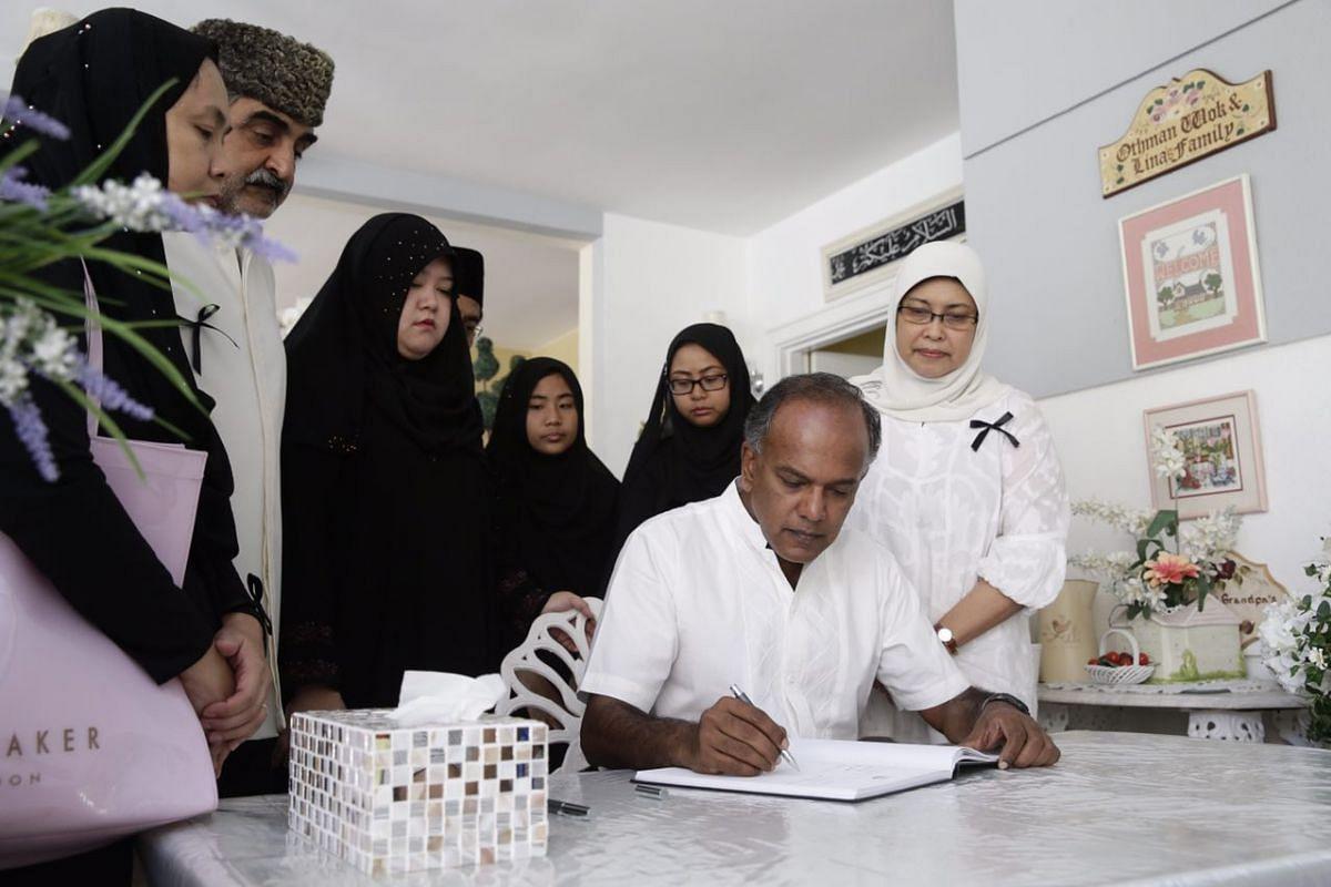 Law Minister K Shanmugam signing the condolence book.