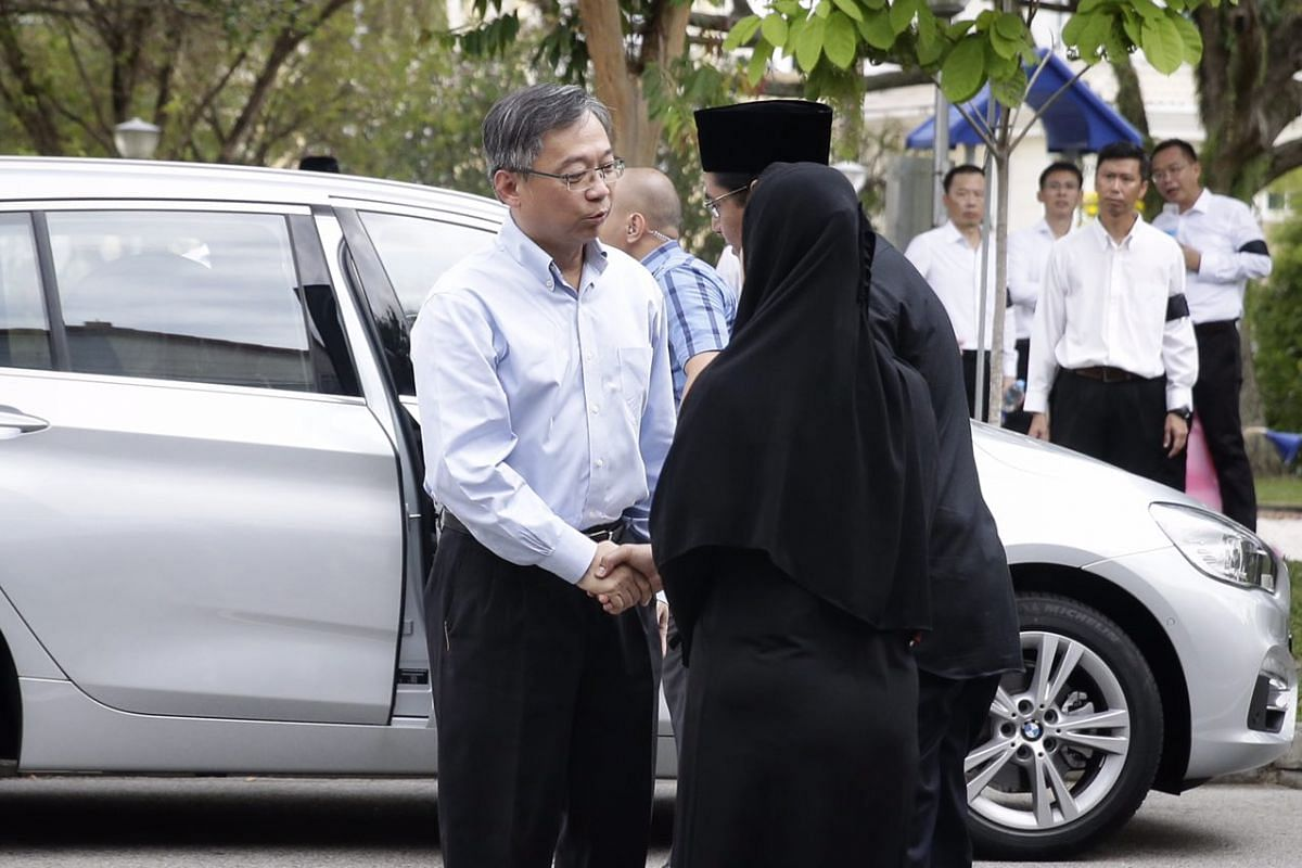Health Minister Gan Kim Yong arrives to pay his respects to the late Othman Wok.