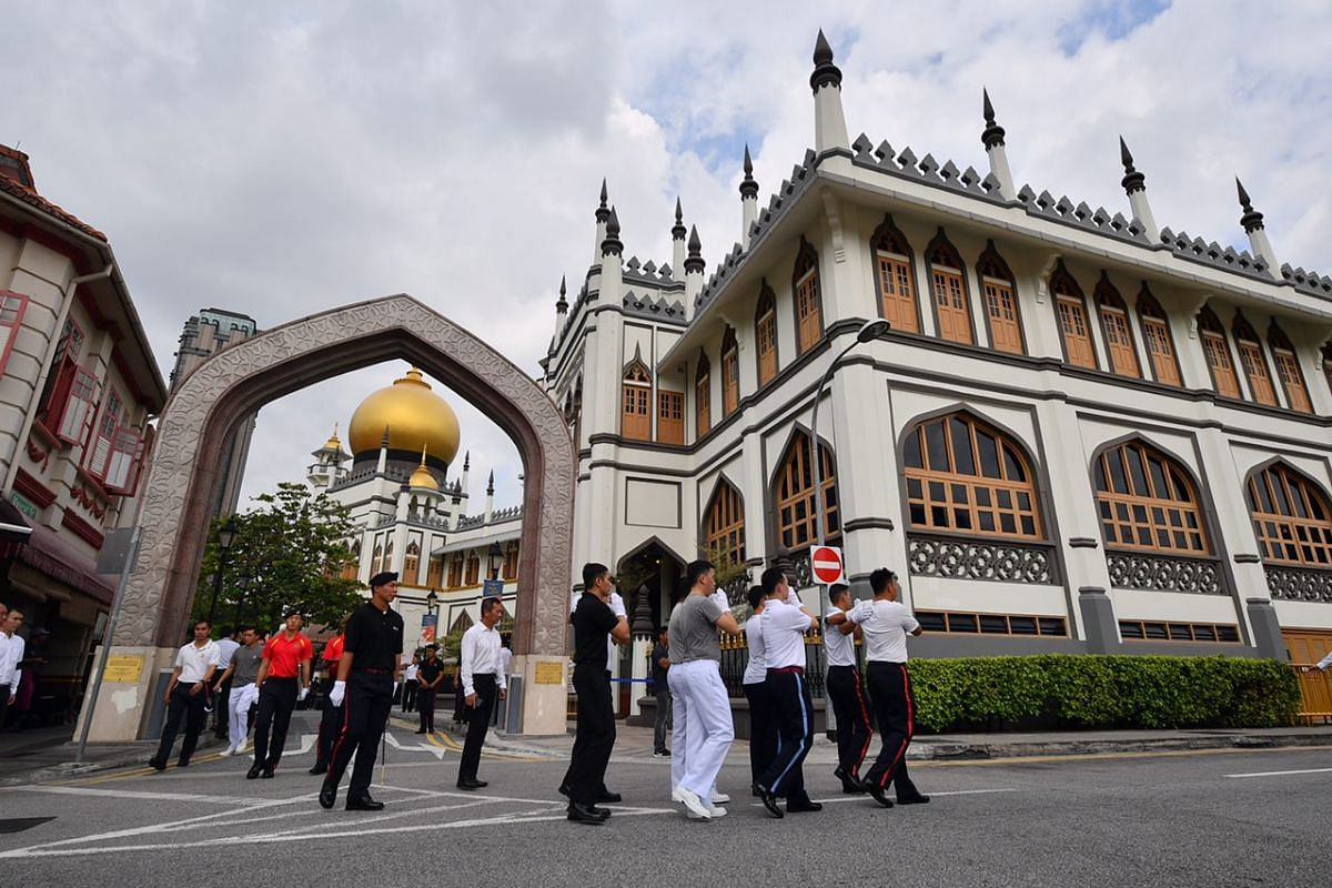 Officers rehearsing at the Sultan Mosque at North Bridge Road on Tuesday morning, before the arrival of Mr Othman's casket for the funeral prayer.