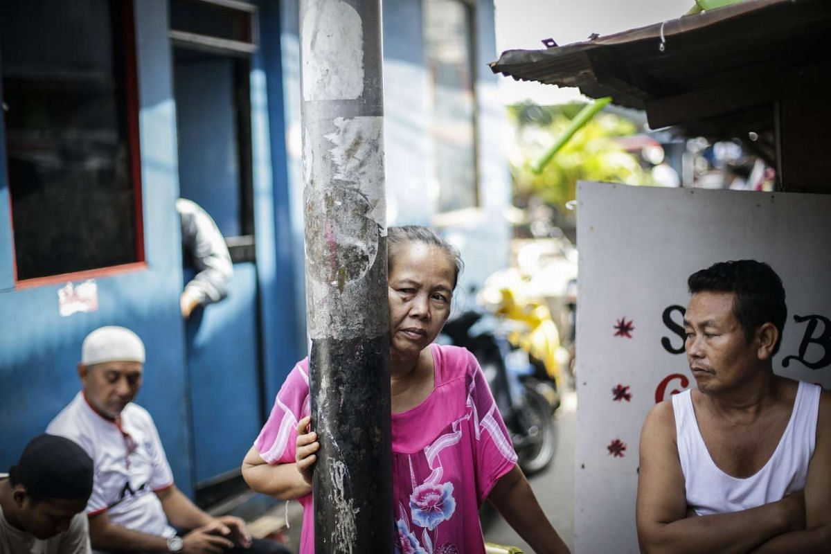 Residents wait for their turn to vote at a polling station in a slum area in Jakarta.