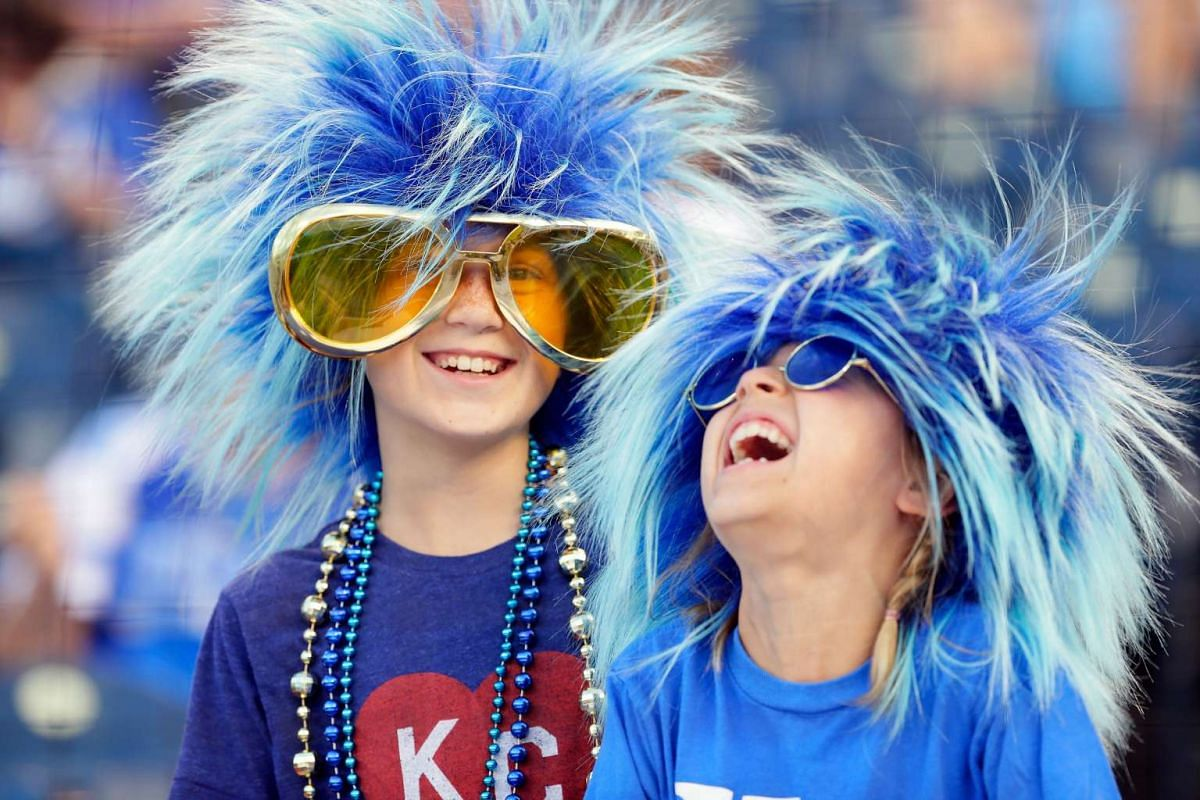 Kansas City Royals fans in funny wigs laugh prior to the game San Francisco Giants at Kauffman Stadium on April 19, 2017 in Kansas City, Missouri. PHOTO: GETTY IMAGES/AFP