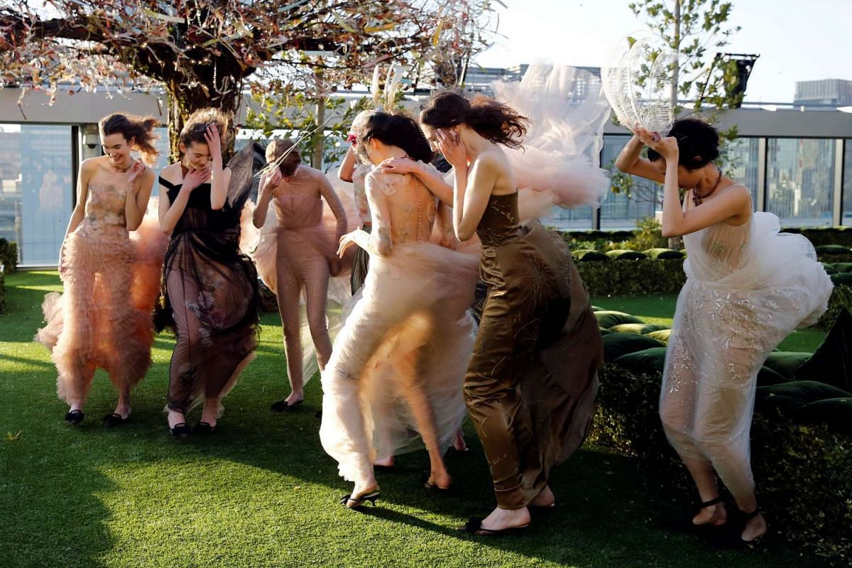 Models struggle against strong wind before the rehearsal of Christian Dior's Haute Couture Spring-Summer 2017 live show to celebrate Dior's new flagship store at the rooftop of Ginza Six mall in Tokyo, Japan, April 19, 2017. PHOTO: REUTERS
