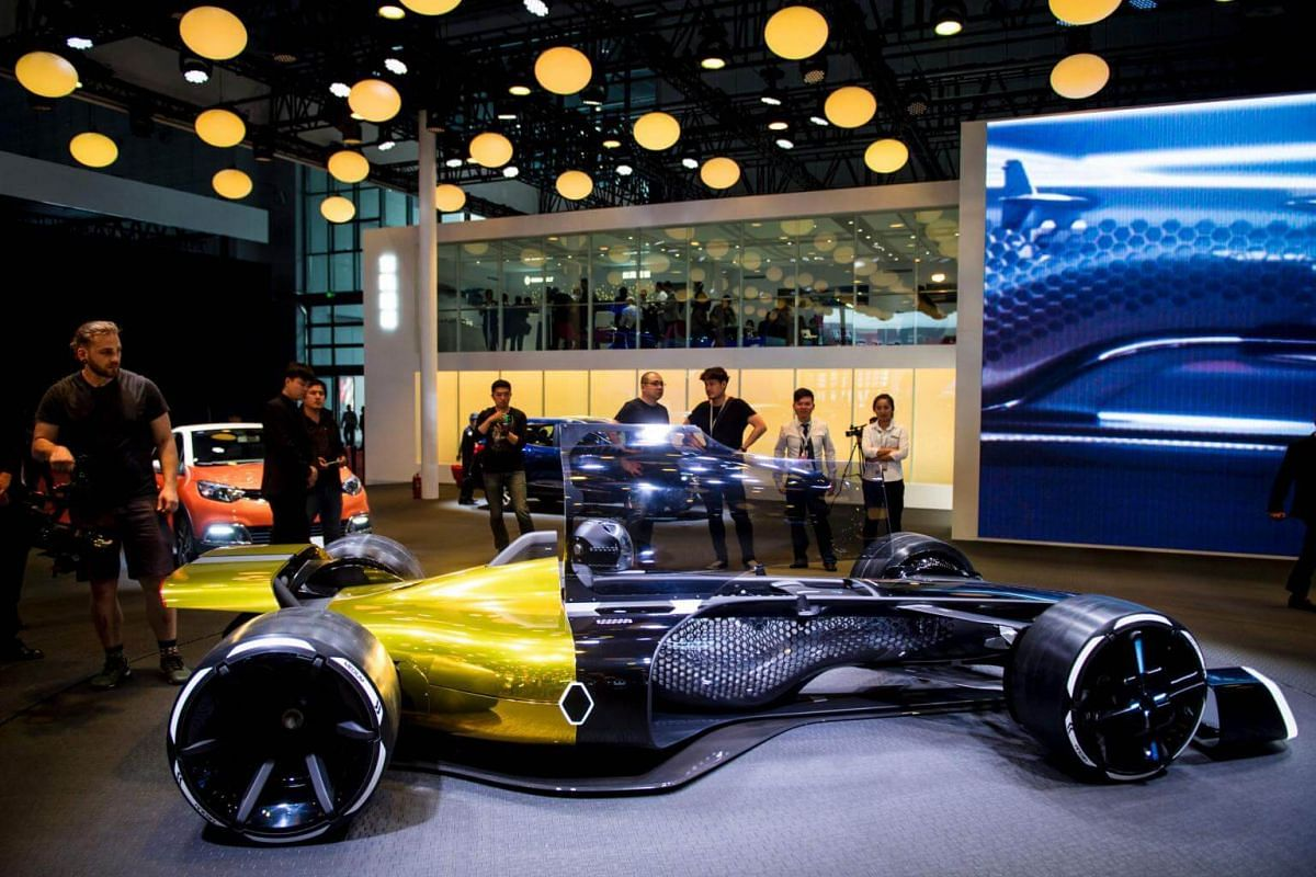 Visitors looking at a 2027 Formula One concept car from French carmaker Renault at the 17th Shanghai International Automobile Industry Exhibition in Shanghai on April 19, 2017.