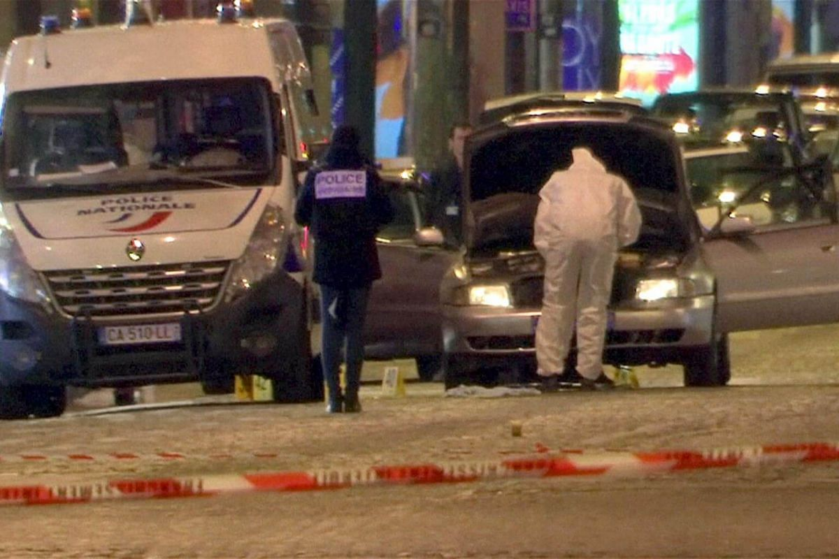 A still image from video footage shows Police investigators inspect the car used by the attacker on the Champs Elysees Avenue after a policeman was killed and two others were wounded in a shooting incident in Paris, France, on April 20, 2017.
