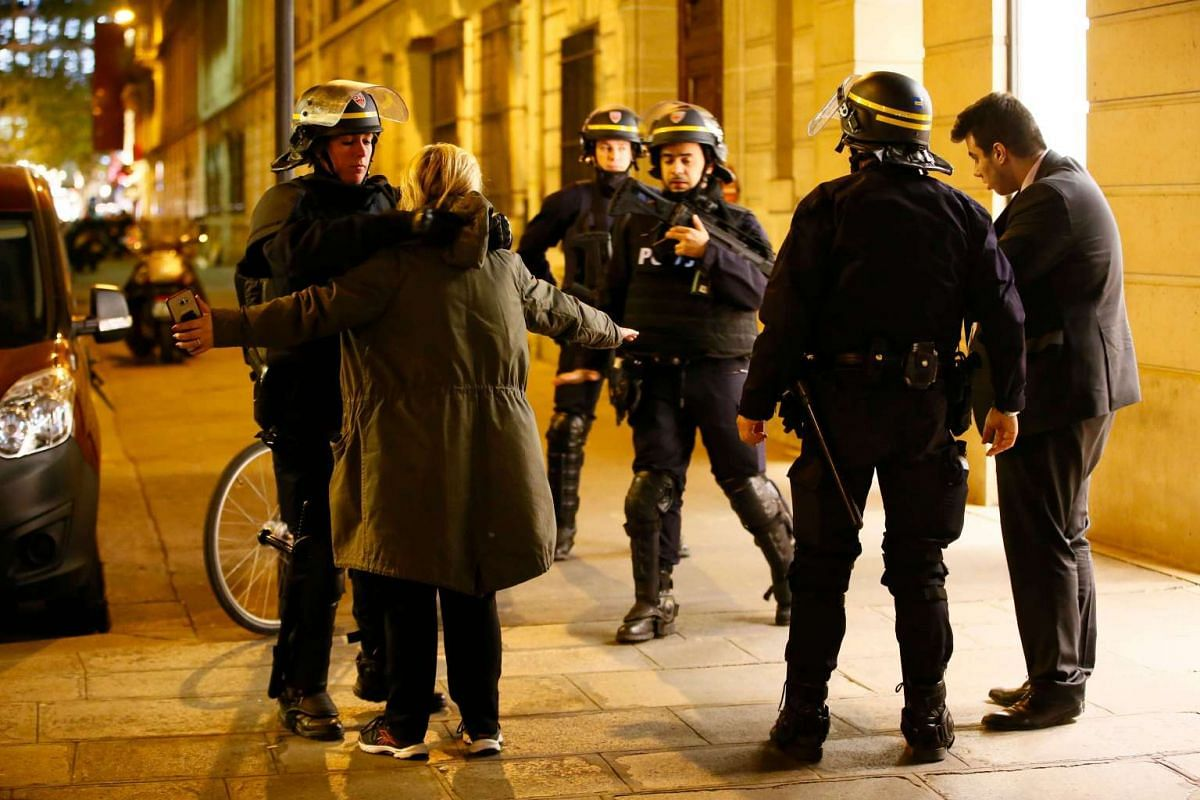 French Police officers search people after a shooting in which two police officer were killed along with their attacker and another police officer wounded in a terror attack on the Champs Elysees in Paris, France, on April 20, 2017.