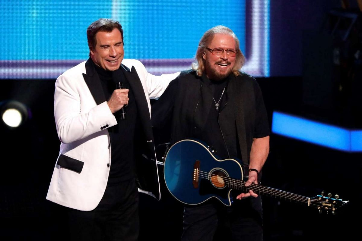 Actor John Travolta (left) and singer Barry Gibb on stage during the taping of the Stayin' Alive, in Los Angeles, California, US, on Feb 14, 2017.
