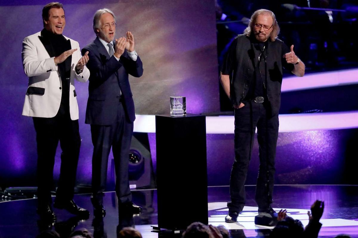 Singer Barry Gibb performing Stayin' Alive with all performers in Los Angeles, California, US, on Feb 14, 2017.