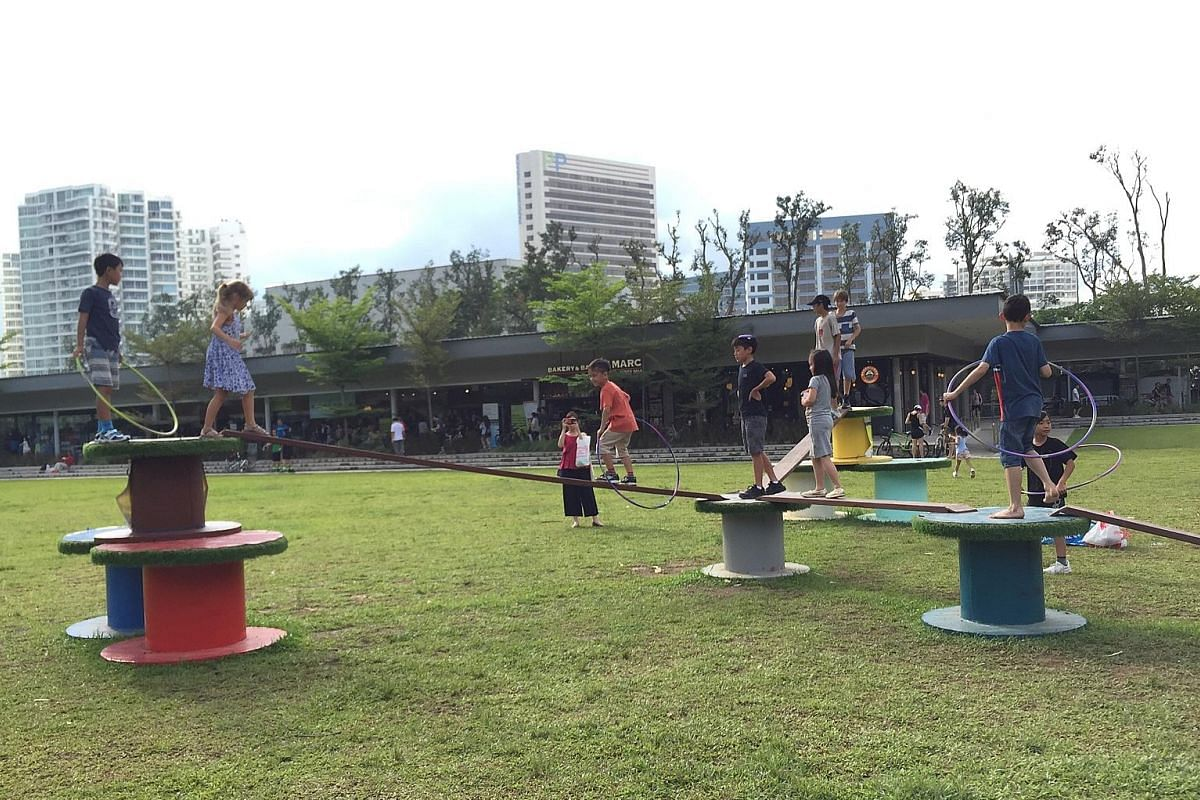 Non-profit public health organisation Singapore Wellness Association's cable spools interactive installation in Parkland Green.